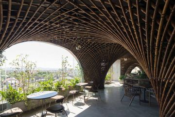 Dome and curved walls of bamboo renew this open-air cafe