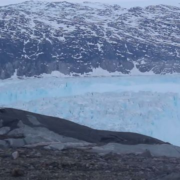 Four-mile-long iceberg breaks off from melting glacier