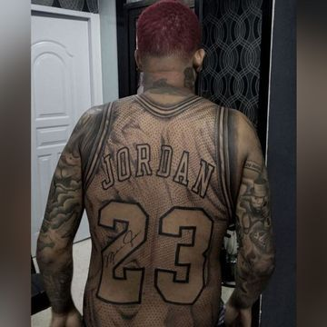 This guy got a full-size Michael Jordan jersey tattoo on his body