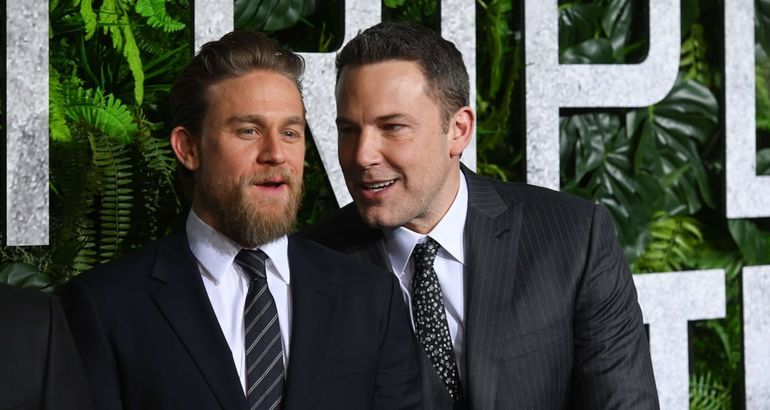 I'm Curious, What's Ben Affleck Whispering to Charlie Hunnam At the Triple Frontier Premiere?